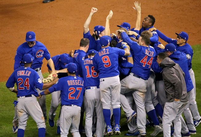 Chicago Cubs celebrating on the mound.