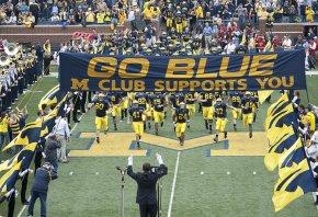 Michigan players running onto field