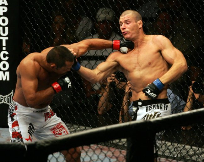 11 July 2009: Dan Henderson on left and Michael Bisping of Britain exchange punches during their middleweight fight at the UFC 100 event at the Mandalay Bay Events Center in Las Vegas, NV.