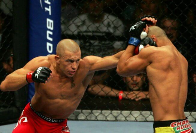 11 July 2009: Georges St-Pierre of Canada on left and Thiago Alves of Brazil exchange punches during their welterweight fight at the UFC 100 event at the Mandalay Bay Events Center in Las Vegas, NV. St-Pierre wins by unanimous decision over Alves in the fifth round.