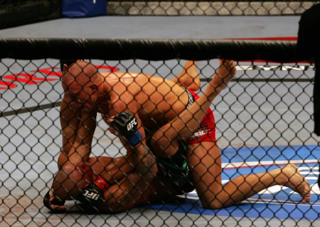 11 July 2009: Georges St-Pierre of Canada on top and Thiago Alves of Brazil exchange punches during their welterweight fight at the UFC 100 event at the Mandalay Bay Events Center in Las Vegas, NV. St-Pierre wins by unanimous decision over Alves in the fifth round.