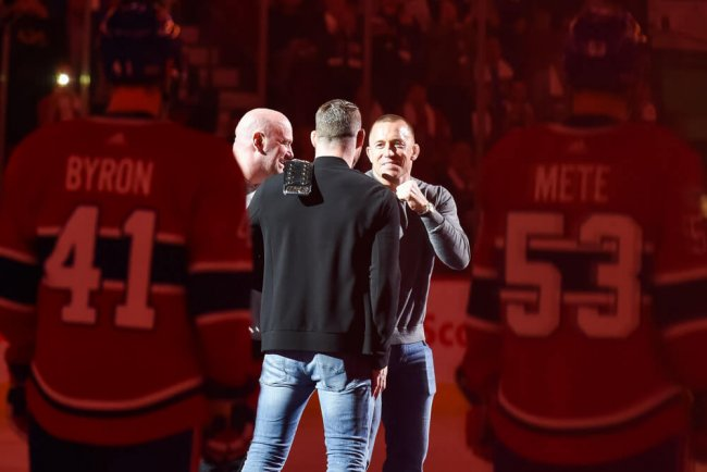 MONTREAL, QC - OCTOBER 14: UFC George St-Pierre facing UFC Michael Bisping at center ice prior to the Toronto Maple Leafs versus the Montreal Canadiens game on October 14, 2017, at Bell Centre in Montreal, QC