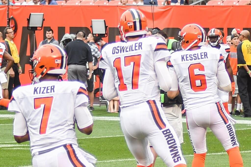 Three Browns QBs warming up.
