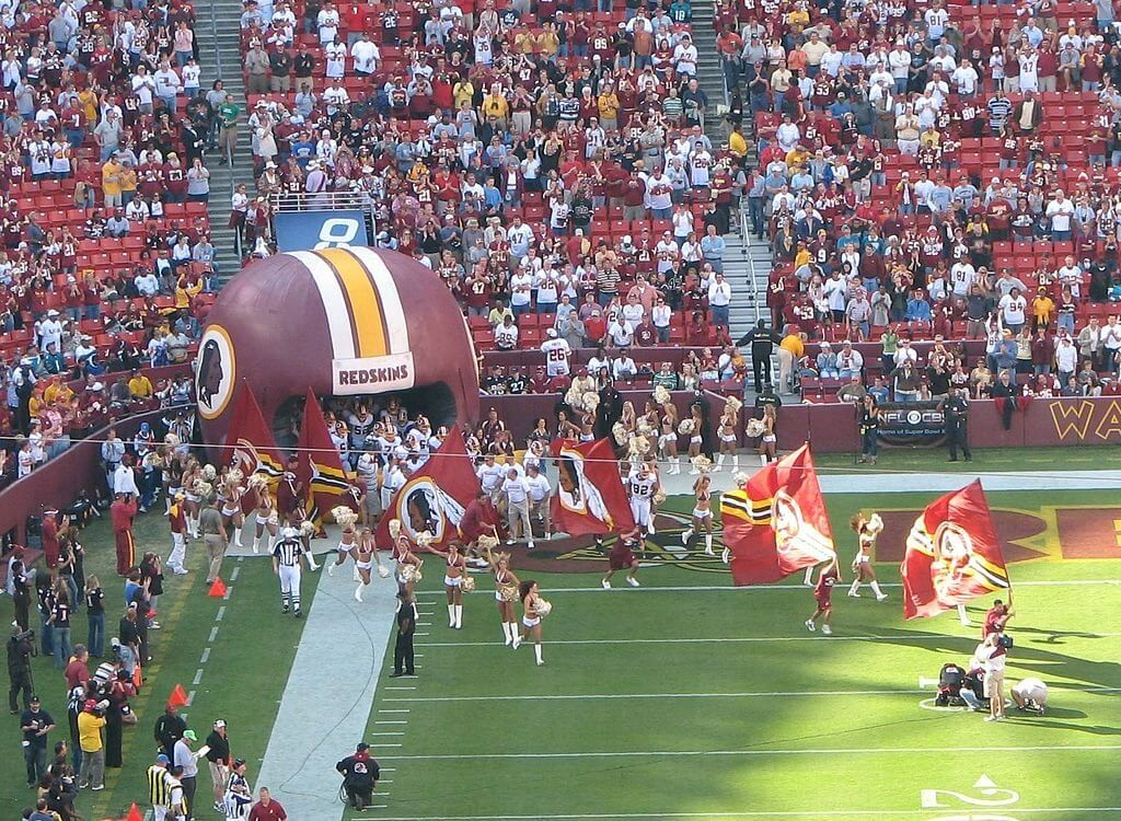 Washington runs out of the tunnel at FedEx Field