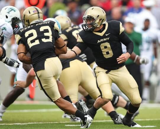 A photo of the Army QB handing the ball off to his RB