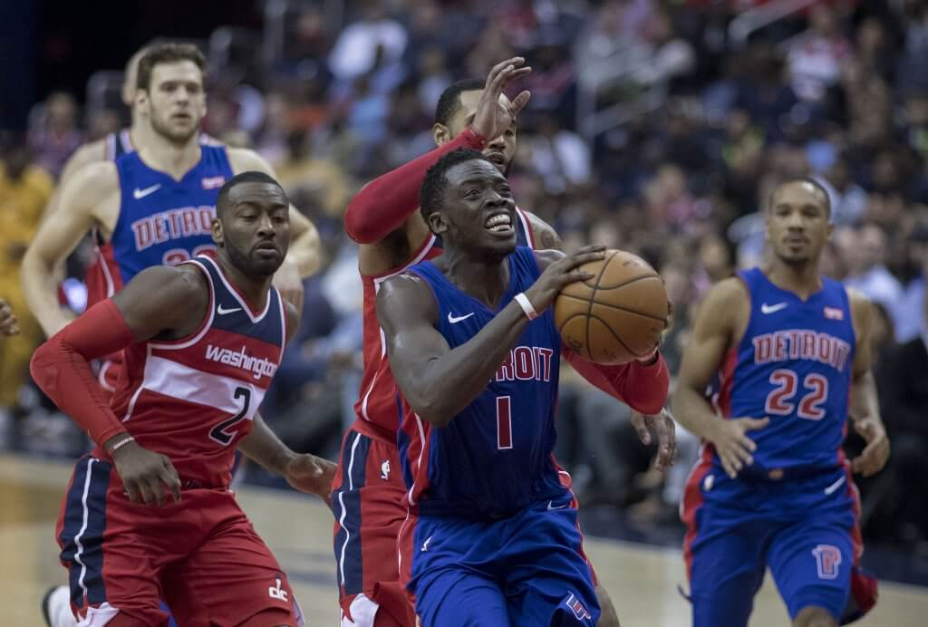 Reggie Jackson drives to the hoop against the Wizards