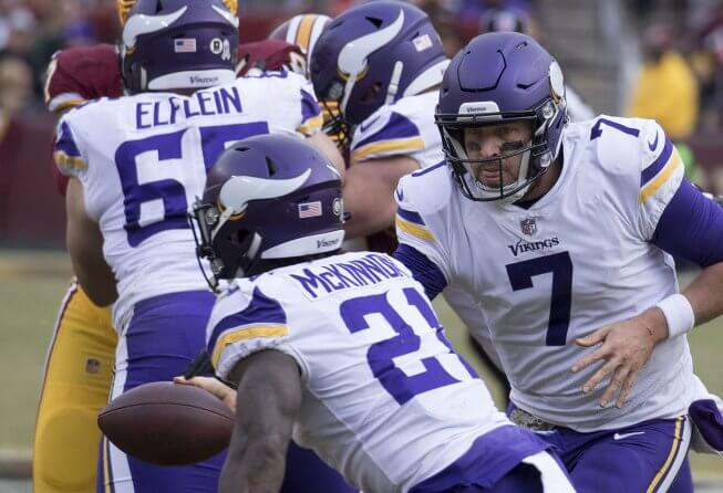 Vikings QB Case Keenum hands the ball off