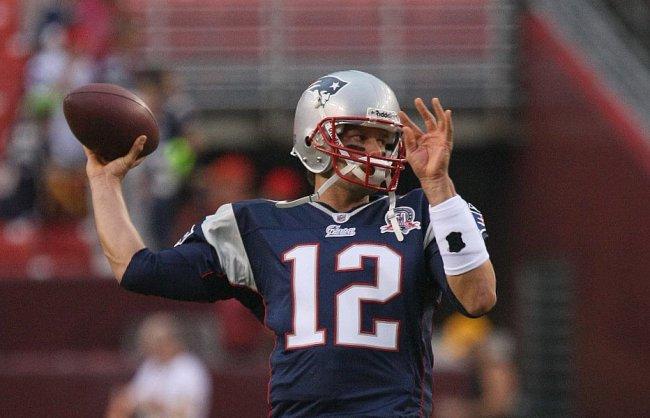 Tom Brady throwing a pass