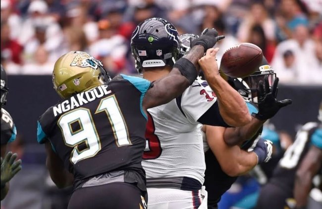 Yannick Ngakoue of the Jacksonville Jaguars making a strip-sack