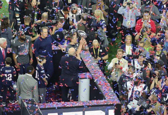Tom Brady celebrating with the Lombardi Trophy.