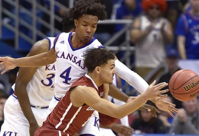 Trae Young of Oklahoma guarded by Devonte Graham of Kansas