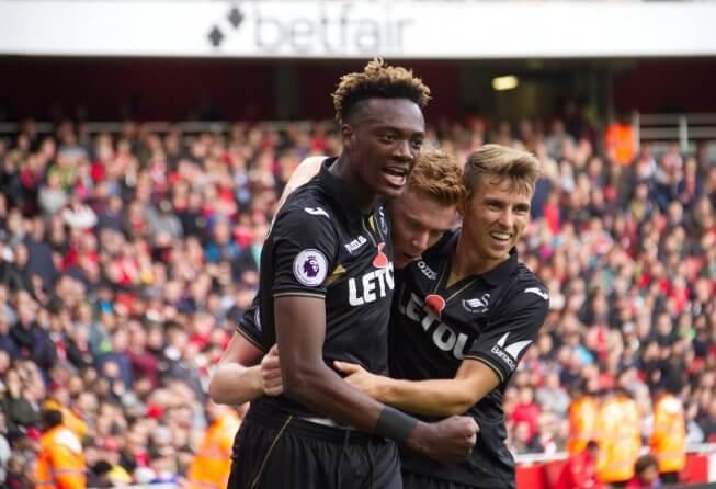 Swansea celebrates a goal.