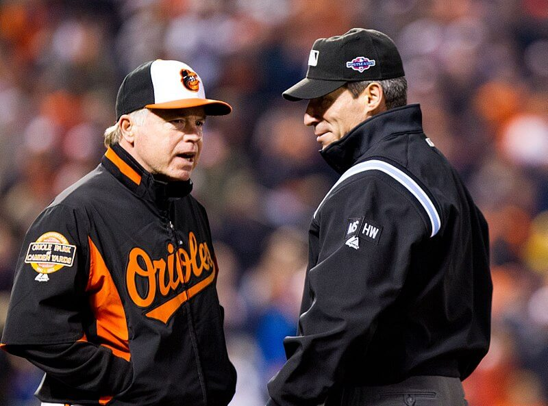 Orioles manager Buck Showalter talking to an umpire