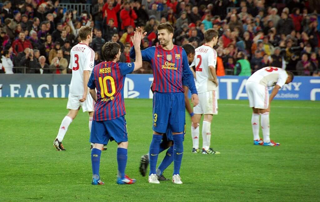 Messi and Pique celebrate.