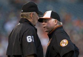 Orioles manager Buck Showalter talking to umpire Bob Davidson