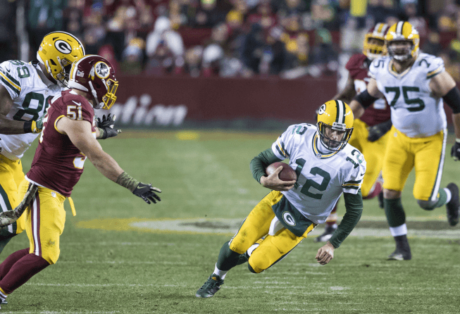 Green Bay QB Aaron Rodgers sliding.