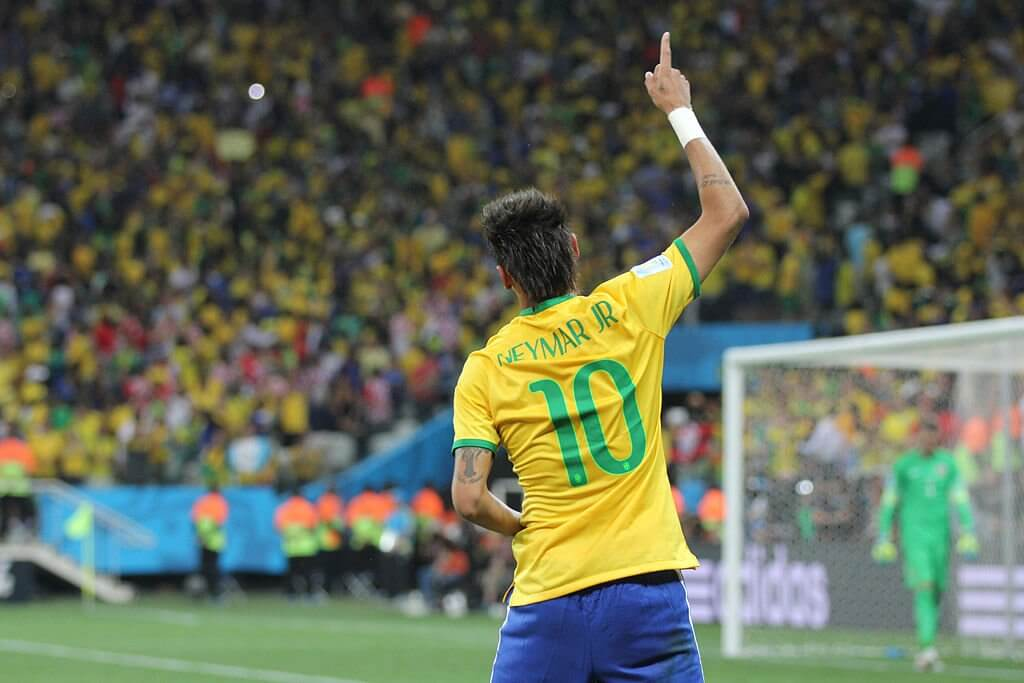 """Once again, the hopes of a nation rests on Neymar's shoulders. The Brazilians are the favorites in 2018, but the ghosts of 2014 still haunt them. (Photo credit: copa2014.gov.br <a href=""""https://creativecommons.org/licenses/by-sa/2.0"""">CC License</a>)"""