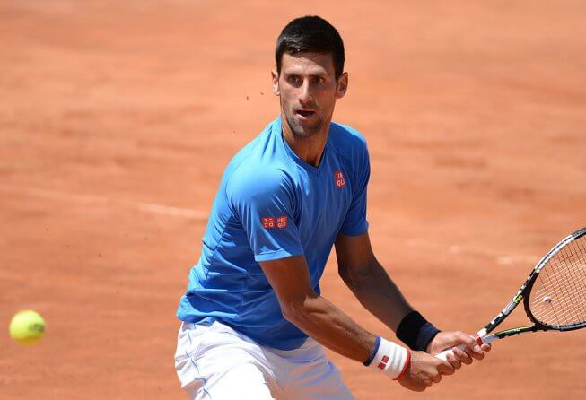 Novak Djokovic playing on clay court