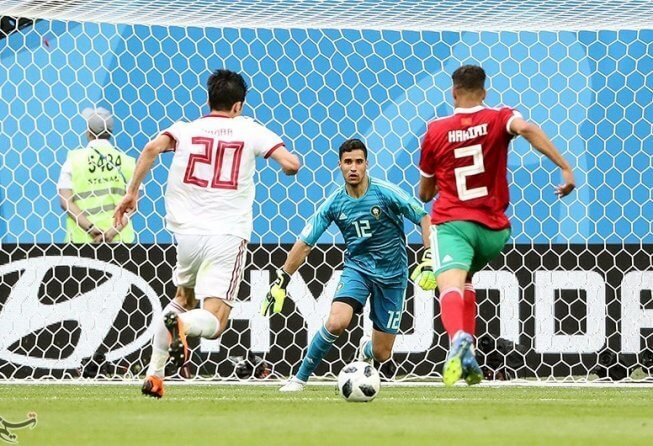 Iran and Morocco play out their Group B match.