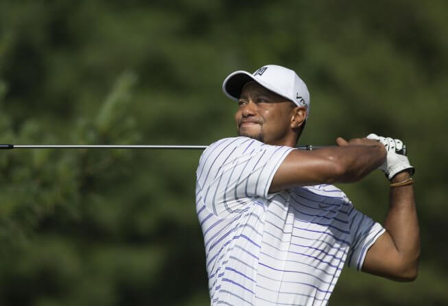 Tiger Woods pauses at the end of his swing.
