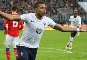 Kylian Mbappe celebrating his second goal for France.