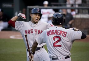 Mookie Betts celebrates at home plate.