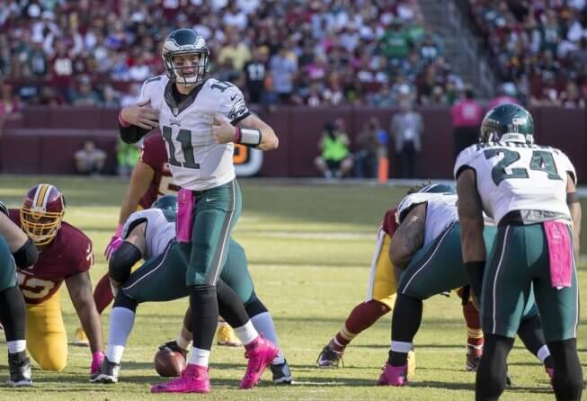 Eagles QB Carson Wentz changing a play at the line of scrimmage.
