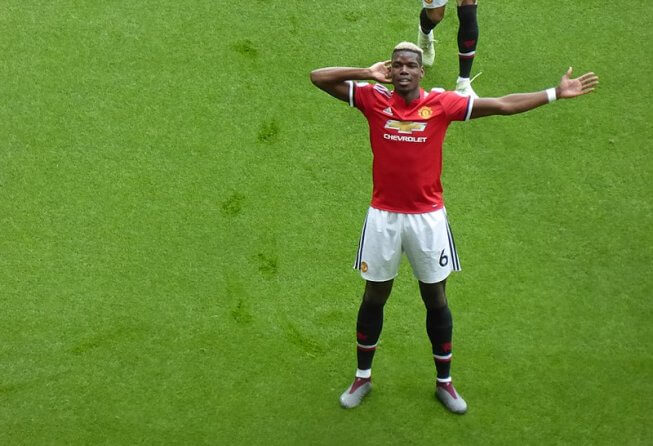 Paul Pogba celebrates a goal with Manchester United.