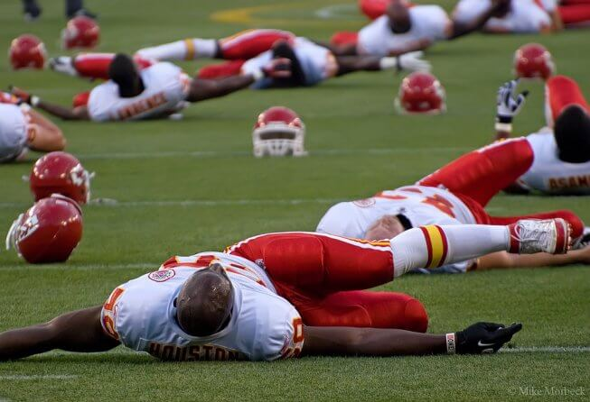 Chiefs players stretching pre-game.
