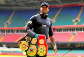 Anthony Joshua with his world titles. He puts them all on the line against Povetkin