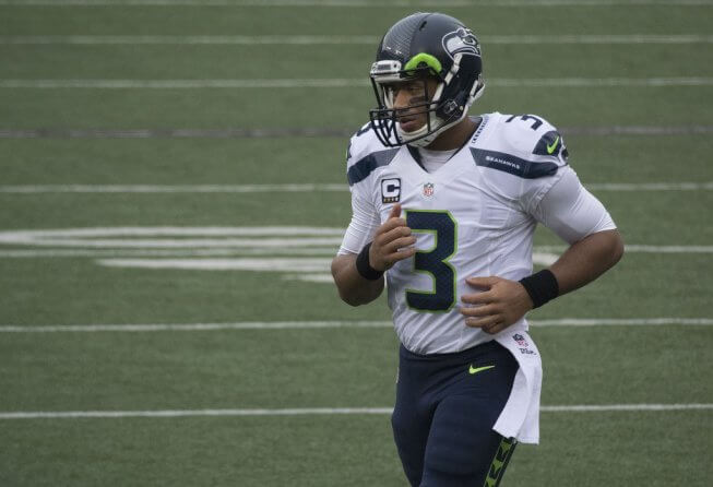 Seahawks QB Russell Wilson jogging off the field.