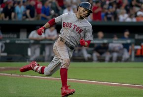 Mookie Betts runs to first base.