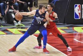 Atlanta Hawks guard Trae Young defends Dallas Mavericks guard Luka Doncic.