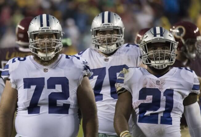 Cowboys offensive linemen Travis Frederick and Richard Ash with RB Ezekiel Elliott.