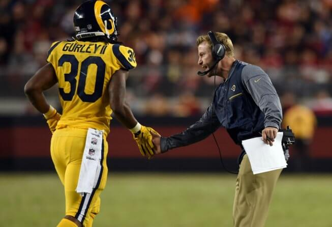 LA Rams running back Todd Gurley high-fiving coach Sean McVay.