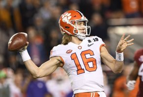 Clemson Tigers quarterback Trevor Lawrence throwing a pass.