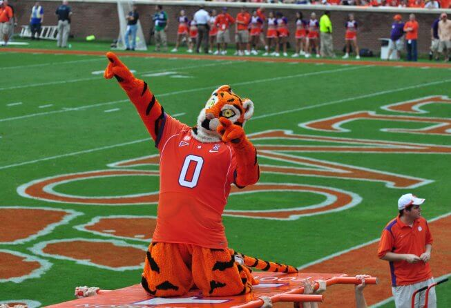 Clemson's football mascot pointing to the crowd.