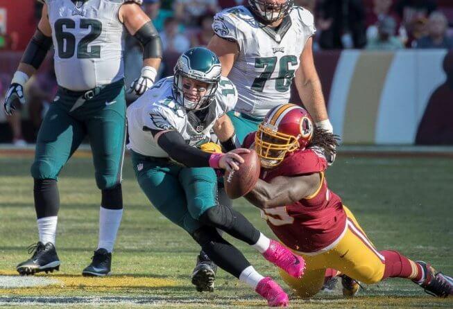 Eagles QB Carson Wentz getting tackled.
