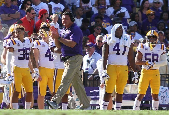 LSU coach Ed Orgeron clapping on the sidelines.