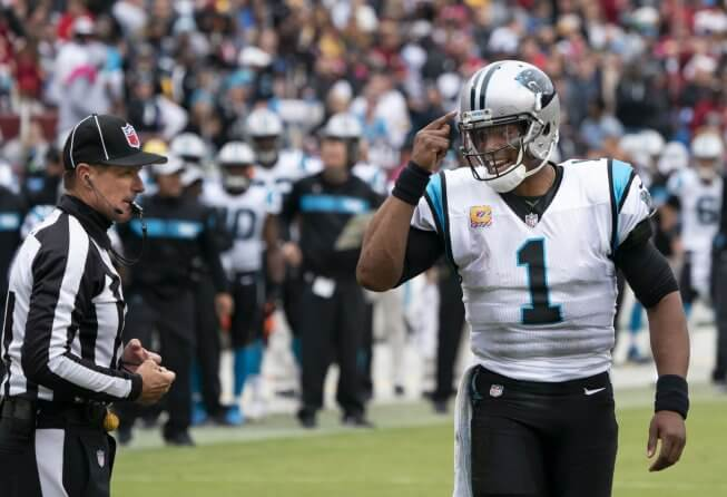 Cam Newton talking to a ref.