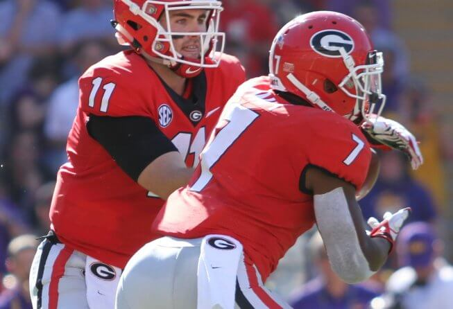 Georgia quarterback Jake Fromm hands off the ball to Georgia Bulldogs running back D'Andre Swift