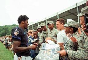 Lamar Jackson signing autographs