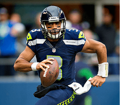 Russell Wilson running with the football