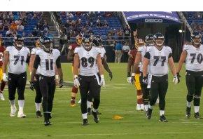 Baltimore Ravens walking to the huddle