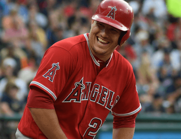 Mike Trout laughing at the plate