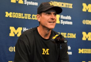 MIchigan coach Jim Harbaugh at a press conference