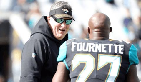 Leonard Fournette talking to Doug Marrone on the sideline